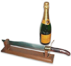 sabre à champagne, with bottle standing ready